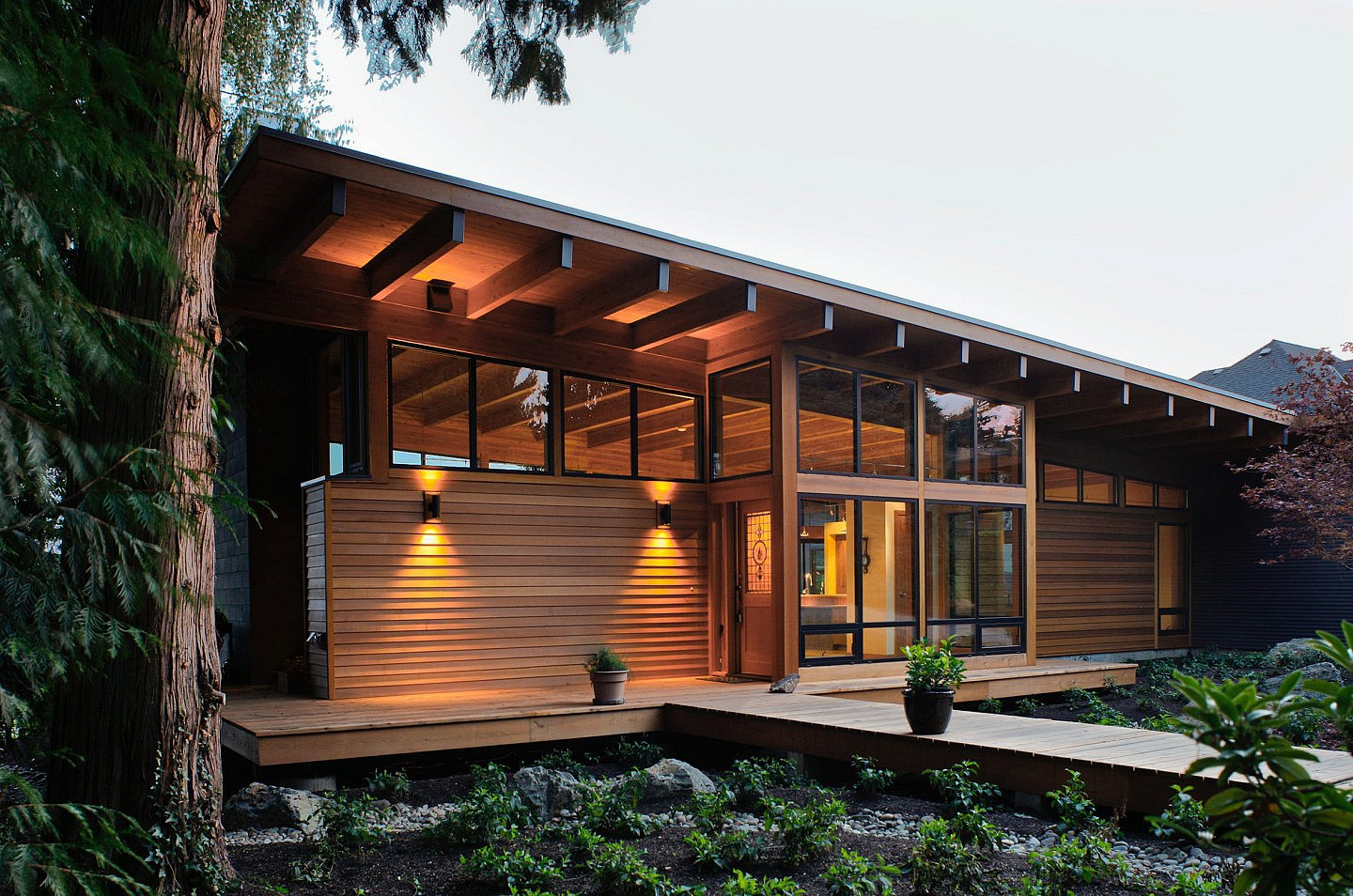 terrific-eco-friendly-house-design-ideas-showcasing-traditional-small-sustainable-homes-with-bamboo-wall-decor-and-glass-sliding-door-panel-also-green-garden-front-yard-inspiration-small-sustainable-h
